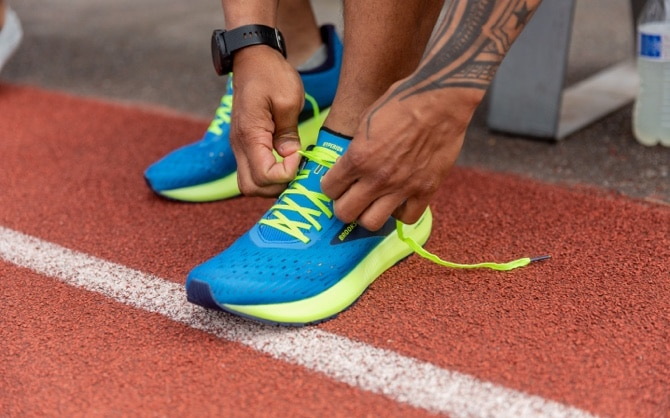 someone tying the laces on a pair of Hyperion tempos