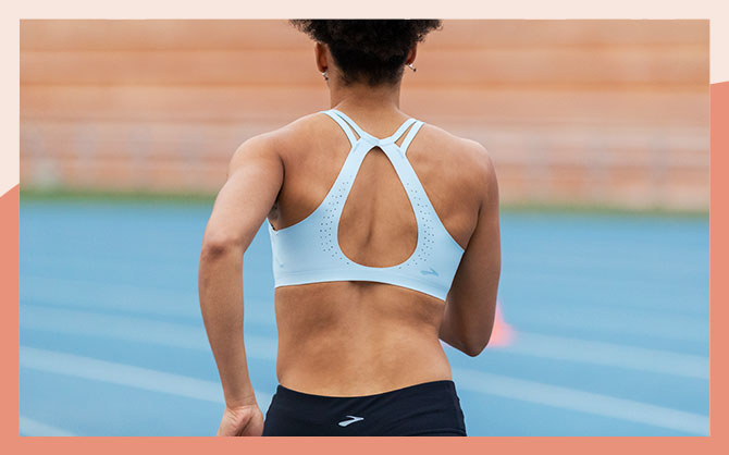 The Dare Strappy run bra, seen from the back to display its strappy, minimal back design.