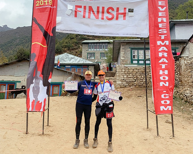 Zander Ross and Richard Ervais at the finish line of the Everest Marathon