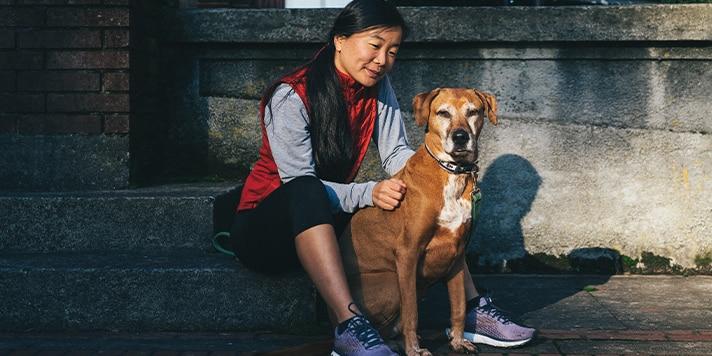 Women sitting with her dog post run
