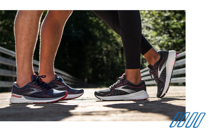 Close up photo of the legs of two runners wearing Brooks Adrenaline GTS shoes with GuideRails technology.