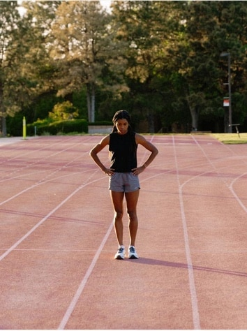 Women standing alone on the middle of the track