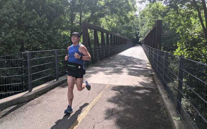 Matthew running over a bridge
