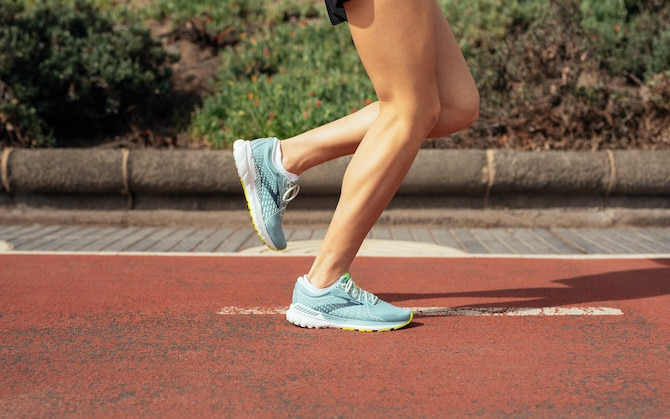 A close-up view of a runner's shins during their stride.