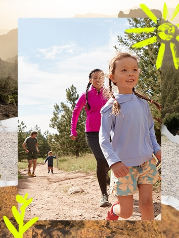 A man and a woman running on trail with two kids
