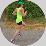 Brooks writer and editor Katherine Pletzke, shown racing a local 10k in Seattle.