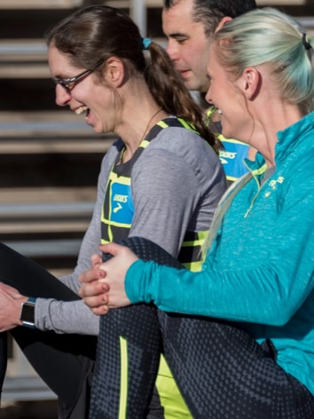 Coleen smiling while stretching before a run