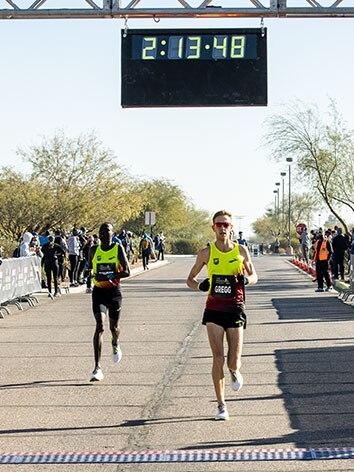 Brendan Gregg crosses the finish line
