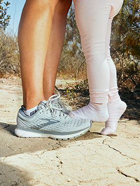 Anels child standing on her Brooks running shoes