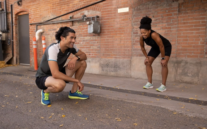 two runners crouching after a run