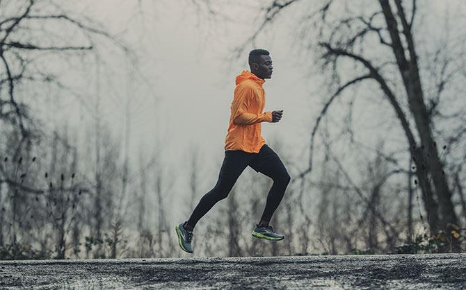 Runner on a dark, cold, wet day.