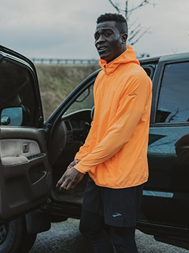Runner getting into a car.