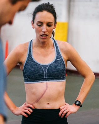 Gabe rocking a scar across her abdomen while at practice
