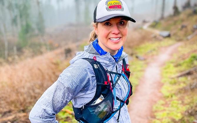 Runner on a trail runner through the forest