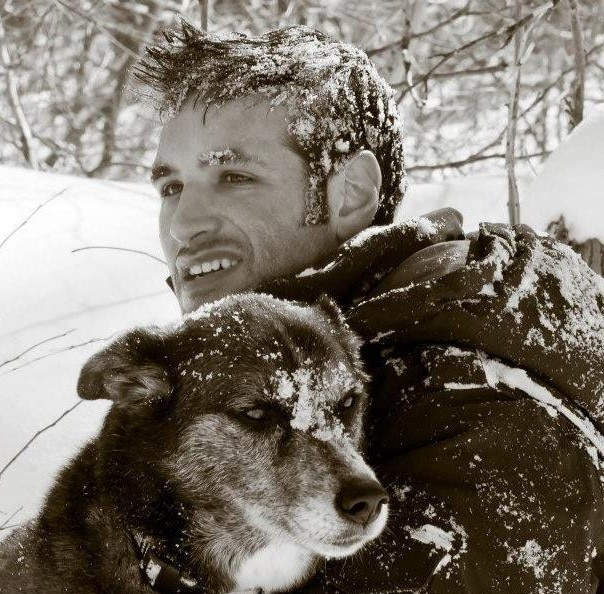 Jonathan with a dog in the snow