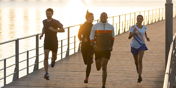 A group of runners enjoys each other's company — while keeping a safe distance between them.
