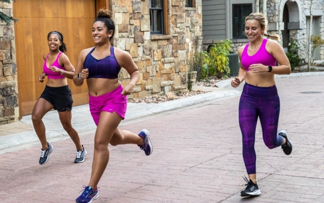 3 runners in pink and purple run bras