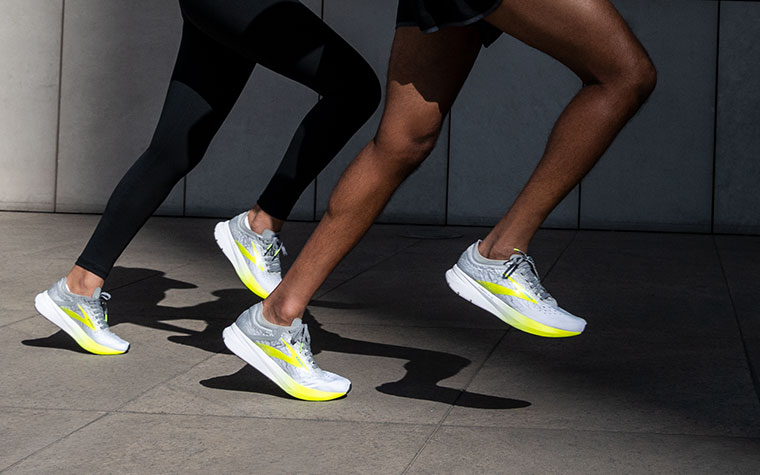 Close-up of two runners' legs in the Hyperion Elite.