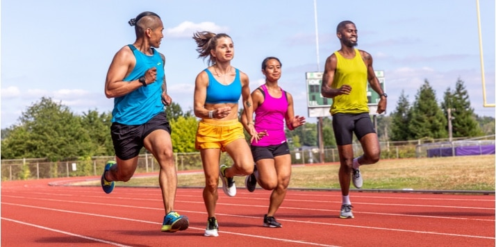 A group of runners on a track running side by side