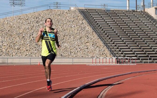 Colleen running around a track