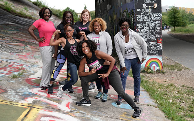 Group of women posing and showing their muscles.
