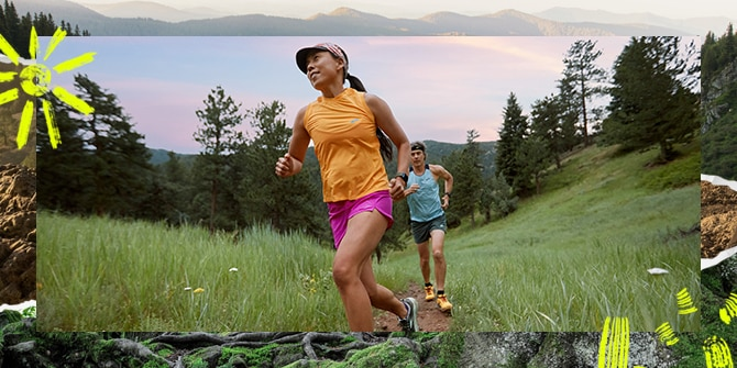 A woman and a man running on trail