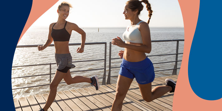 Another pair of women runners get their workout done with the ocean in the background.