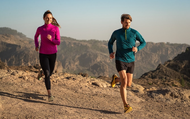 Two runners on a rocky trail
