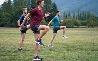 Runners warming up in a field
