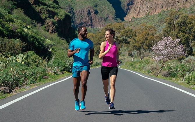 Two people running outside