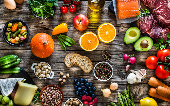 An array of fruits, vegetables, and grains spread out.