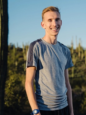 Adam Dalton standing outside smiling