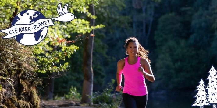 Women running through a forest