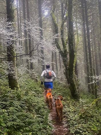Ryan Bhark, footwear developer at Brooks Running, on the trail with his dog Cedar