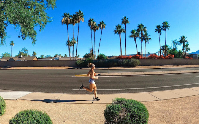 Runner with palm trees in the background