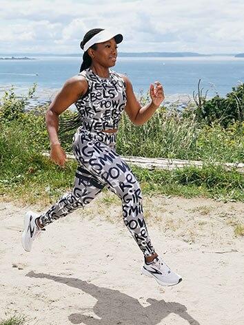 Olu running with the ocean behind her