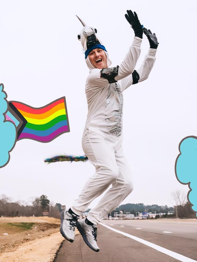 Runner in unicorn onsie jumping