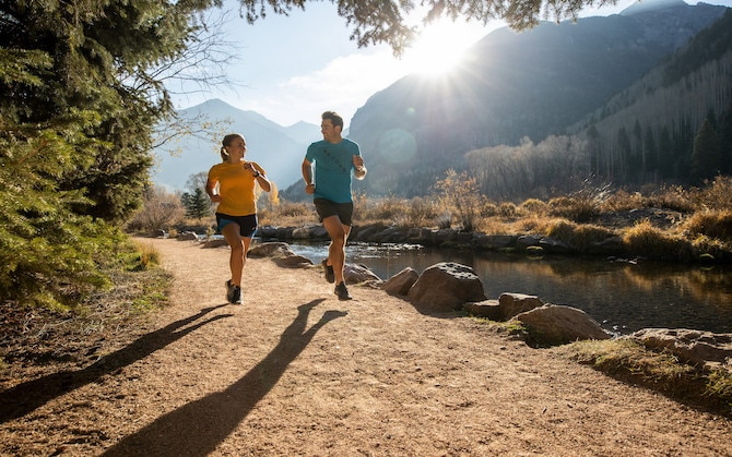 Two runners on a trail run
