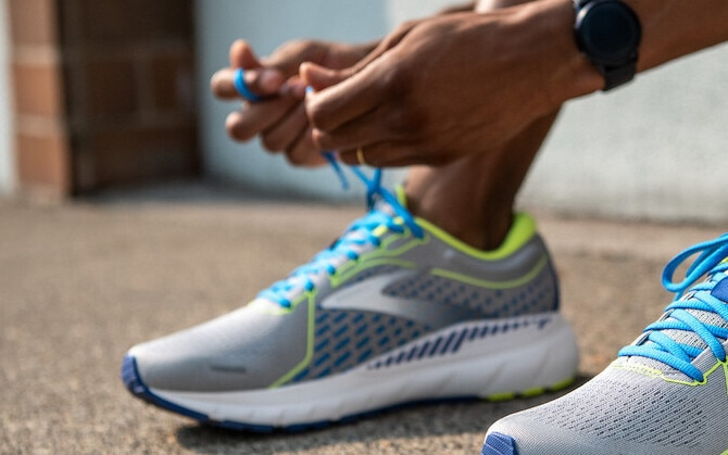 Runner tying their shoes