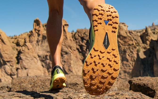 the bottoms of a pair of trail shoes