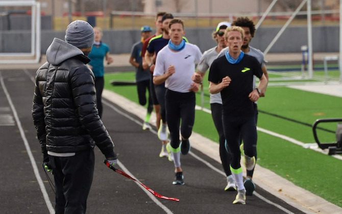 Runners training on a track