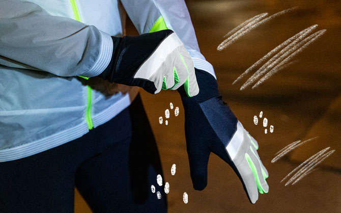 Closeup of a runner putting on Brooks Run Visible Carbonite Gloves.