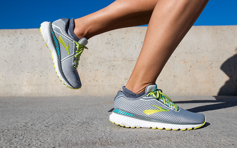 Close-up of a runner's feet in the Adrenaline GTS, mid-stride.