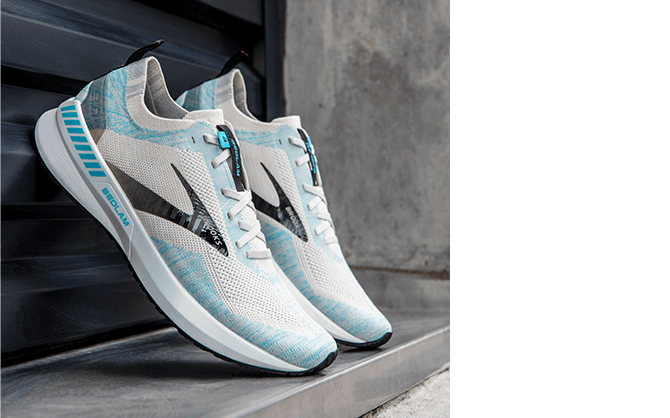 A pair of the Brooks Bedlam 3 road-running shoes is positioned against a wall.
