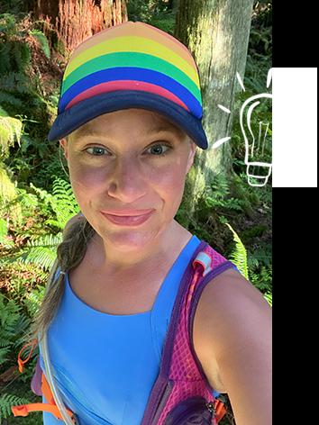 Woman taking a selfie on a run, wearing a rainbow hat