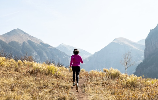 A woman running on trail