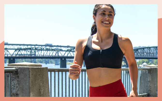 The Dare Zip run bra, seen from the front with its secure zip closure.