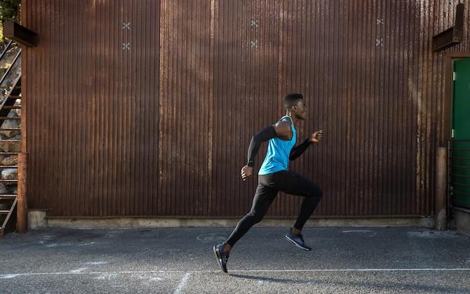 Runner running down the sidewalk