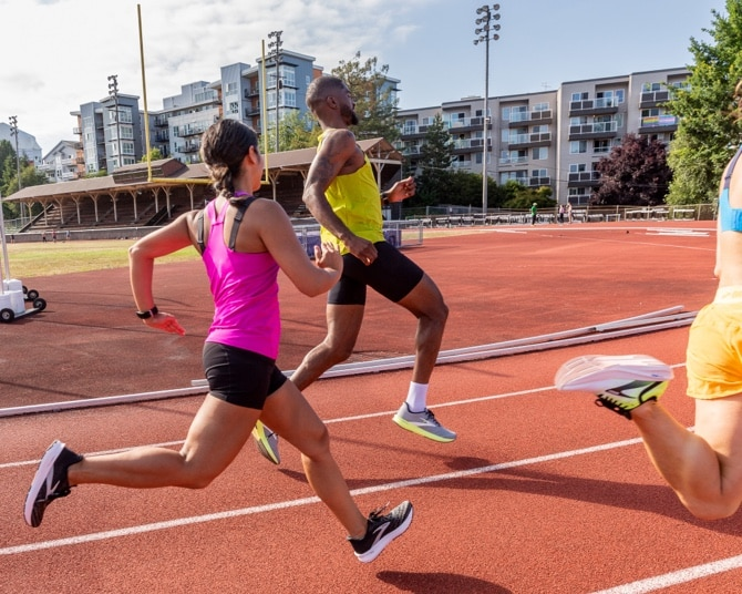 A group of runners on a track, sprinting