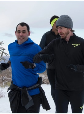 Andy smiling on a run in the snow